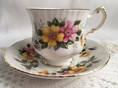 Paragon china tea cup and saucer with pink and yellow floral and gold trim. Excellent condition with no chips, cracks or crazing. IMPORTANT Shipping Information: Shipping cost for all of my items will add up correctly for up to 3 cups and saucers. For orders of 4 or more, please