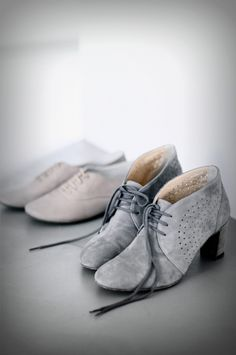 suede booties...I'm loving the soft gray-blue and the furry inners and the gentle decoration by perforation...