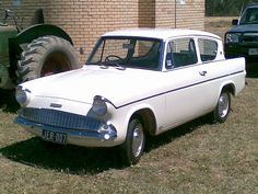 1961 Ford (English) Anglia DeLuxe - my very first car. Vintage Cars, Antique Cars, Vintage Signs, Ford Anglia, British Sports Cars, Ford Classic Cars, Classic Motors, Limousine, Top Cars