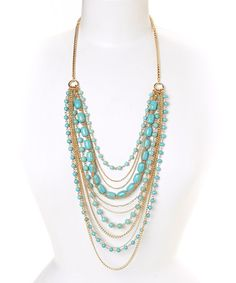 Love this Turquoise & Goldtone Bead & Chain Bib Necklace by Fantasy World Jewelry on #zulily! #zulilyfinds