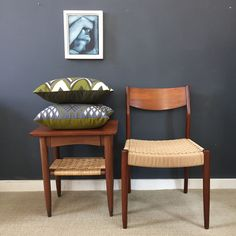 Mid Century Side Table with Woven Shelf, Danish cord chair, handloomed Mayan pillows from Guatemala, painting by Amy Goodwin