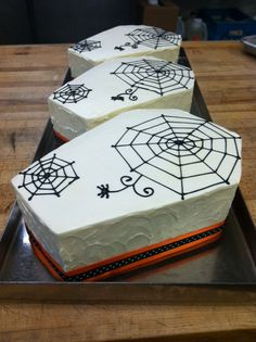 Creepy (yet delicious) coffin cakes: chocolate cake, peanut butter mousse and vanilla buttercream by dahliabakery, via Flickr