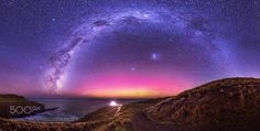 Earth Day Aurora  April 22nd  Akaroa Heads Lighthouse  The Galactic Milky way arches over the Aurora Australis and Akaroa lighthouse. First time to this spot and I love it with the winding path and the light central the arch in the sea the slopes and curves and the light from tens of thousands of years ago in the sky. Every picture tells a story this one is all about the night sky and the absolute joy it can bring. I was literally shouting out here glad I was alone otherwise people would…