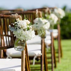 A C C E N T S -  don't forget to order a little something for your ceremony aisle chairs when ordering your flowers.  Not only does it dress up the aisle beautifully but these lovelies can be repurposed at the reception - on the bar cocktail tables guest book table - a little touch that has a big impact.