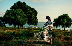 The Golden Hour - Lupita at Dunga Beach, near the shores of majestic Lake Victoria. Chloé dress. Cara Croninger earrings. Christian Louboutin sandals.