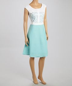 Revamp the dress wardrobe with this color block number. Ramie-blend construction keeps figures cool, while a tucked waist and bodice embroidery provide chic figure definition.