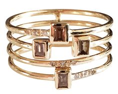 Stack ring in 14k gold with 0.31 ct. t.w. colorless and champagne-color baguette-cut diamonds;