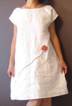 pure linen dress white with rust pleated flowers custom order listing. $138.00, via Etsy.