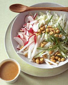 In a coarsely cut cabbage-and-daikon-radish slaw, many of the components -- the peanut dressing with ginger and soy sauce, as well as the daikon -- give it an unmistakably Asian character. Radish Recipes, Slaw Recipes, Healthy Recipes, Healthy Foods, Cantaloupe Recipes, Vegetable Recipes, Free Recipes, Peanut Dressing, Clean Eating