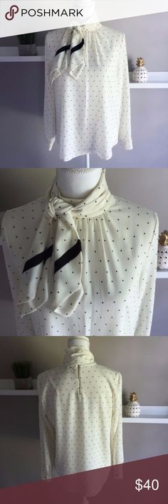 "Vince Camuto Polka Dot Necktie Blouse Cream and black Polka dot Blouse from Vince Camuto. Long sleeves with back neck zipper closure. Polyester blend is wash and wear. Modern necktie accent. Measures 20"" across the chest and falls 26"" from the shoulder. Excellent condition, no flaws. Vince Camuto Tops Blouses"