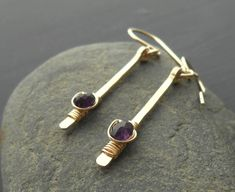 These earrings are made using small amethyst rondelles wire wrapped onto hammered gold dangles that are made using gold filled wire. Ear wires are also made from gold filled wire. Total length is 1 Gold Drop Earrings, Dangle Earrings, Hammered Gold, Jewellery Designs, Barrette, Jewelry Crafts, Dangles, Amethyst, Jewelry Making