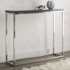 Features:  -Construction Material: Lacquered manufactured wood tabletop with a polished stainless steel frame.  -Hollow core construction.  Top Material: -Solid Wood.  Base Material: -Metal.  Hardware