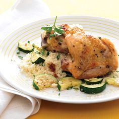 Roasting chicken thighs with their skin on helps keep the meat moist, while the pan juices lend lusciousness to the zucchini that roasts alongside.