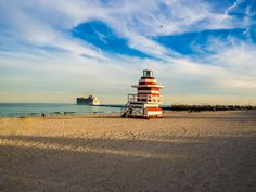 Sunset sunday afternoon in Miami Beach, with a ship leaving the pier