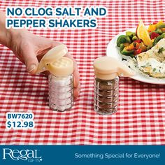 """NO CLOG SALT AND PEPPER SHAKERS from Regal Gifts No more salt and pepper stuck in the shakers in the summer or humid areas. The spring-hinged tops seal the moisture to keep the contents flowing smoothly; no rice or tricks. Glass bottles with plastic lids. 3-1/2""""H x 1-1/2""""Diam. Product: BW7620 http://www.Regal.ca"""