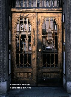 Cast and wrought iron with gold plating surface. Entrance to an apartment building in Budapest Hungary