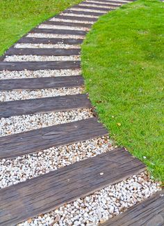 This curved walkway is comprised of alternating weathered wood and white pebble segments. Discover all kinds of walkway ideas in this extensive front and backyard walkway photo gallery. Brick, pavers, flagstone, concrete, gravel walkways and more. Front Walkway Landscaping, Front Yard Walkway, Gravel Walkway, Wood Walkway, Backyard Walkway, Outdoor Walkway, Backyard Landscaping, Walkway Ideas, Landscaping Ideas