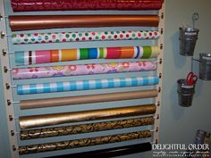 Cafe Curtain Rods make a great Wrapping Paper holder! Walls, doors.... the ideas are endless!