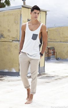I'd have to start working out to wear this tank. Or risk looking like a bleached popsicle stick with bleached toothpicks for arms.