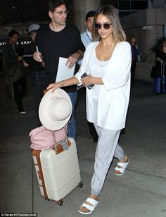 Jet-setting: Jessica touched down at LAX on Thursday, wearing a casual ensemble including ...