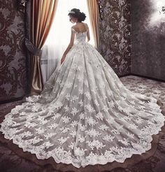 Incredible floral lace embroidered off-the-shoulder wedding dress with royal bridal train; Featured Dress: MillaNova
