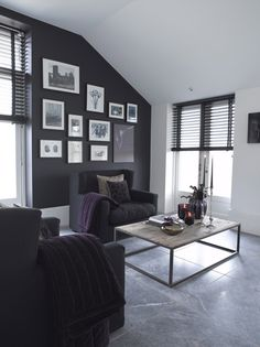 Gallery arrangement on dark wall