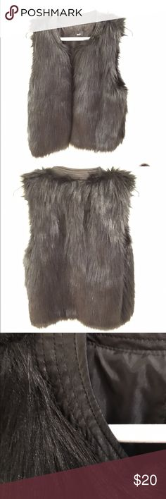 Mossimo black fur vest NWOT Mossimo XS black fur vest with leather piping along collar, never worn Mossimo Supply Co Jackets & Coats Vests