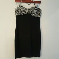 Forever 21 Black & White Dress Dress from Forever 21. Has a bit of a stretch as it's made with some spandex. Really flattering and slimming to the figure. Versatile style can be worn as a halter dress or you can detach the halter to make a tube dress. Only worn once. Good used condition.  Fits like a true small but tag reads medium. Forever 21 Dresses