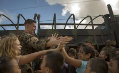 Marines bring smiles to Tinian kids during Exercise Forager Fury II.  (U.S. Marine Corps photo by Lance Cpl. Antonio Rubio/Released)