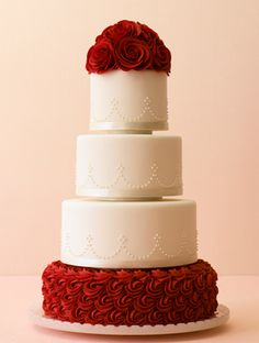 The Classic Wedding Cake: We could stare all day at this classic cake with red sugar roses and dainty piping.