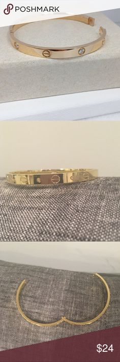 Gold Love Bracelet w/ rhinestones NEW!  Gold hinged Love Bracelet with rhinestones  (Looks like Cartier Love Bracelet!)  Price is firm. No trades. Jewelry Bracelets