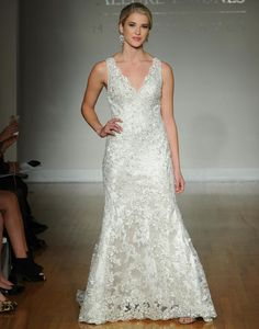 Allure fall 2016 wedding gown with V neckline, A line gown with lace and beading throughout   https://www.theknot.com/content/allure-wedding-dresses-bridal-fashion-week-fall-2016