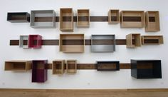 Sliding shelves in various shapes that can be rearranged to suit, design by Berlin architect Lutz Hüning