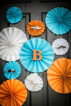 Aqua, orange and white mustache fans for a co-ed baby shower mustache bash. Decor by Wallace & Co Events