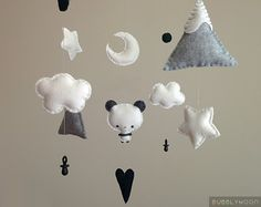 MADE TO ORDER Please check my shop announcement or ask for the current turnaround time. »-› Panda, mountains, clouds, moon & stars baby mobile »-› Colours can be customised to your liking if preferred All of my mobiles are made with a lot of patience and care. ♥. DIMENSIONS: Frame: 12x12 Inches Felt Parts: 0.5-5 Inches ♥. DELIVERY TIMES; (Once your order has been made.) Please check shop announcement for current order completion time. UK: 1-3 days Everywhere Else: 5-7 working days....