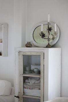 white chippy cabinet / vintage mirror / candelabra