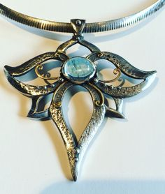 Aquamarine Lotus Flower Pendant.  Silver and 22k gold Handcrafted by Melissa at  www.melissacaron.com