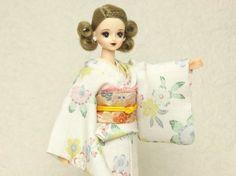 She is Jenny's friend Marry in Japanese kimono dress.