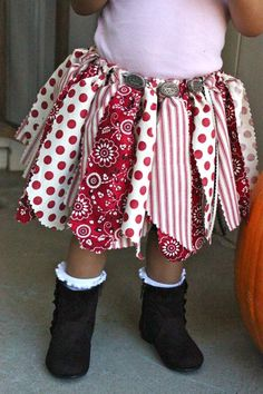 Morgan is going to be a cowgirl for Halloween. I'm using this style but with cow print and bandana print fabric and tule ;) and REAL cowgirl boots of course!