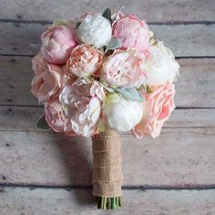 elegant peony bouquet with whites and soft pinks wrapped in burlap - rustic and romantic.