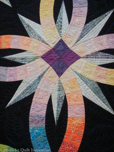Midnight Wedding Star by Josephine Keasler, quilted by Carole L. Sturgis. Design by Judy Niemeyer. Closeup photo by Quilt Inspiration: 2015 Springville (Utah) Quilt Show.