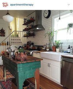 Classic white kitchen gets a pop of color with green island, bright rug, and open shelves. - Modern Home Kitchen Rug, New Kitchen, Kitchen Decor, Country Kitchen, Kitchen Ideas, Kitchen Island, Kitchen Runner, Island Table, Boho Kitchen