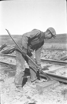 Pulling Spikes, 1920s not much has changed pulling spikes by hand  now.