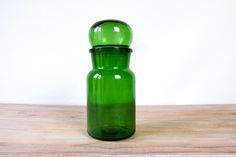 Vintage apothecary green glass bottle