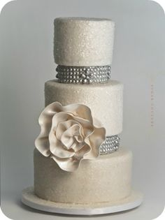Chic White Wedding Cake - Sugar Couture...if they could make the bands match the band on my wedding dress, would be SO neat!