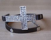 Cross bracelet with leather cord. $25.00, via Etsy.