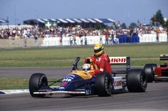 Silverstone, 1991: Nigel Mansell gives Ayrton Senna a lift back to the pits. World Copyright: LAT Photographic; Image courtesy Williams F1 team (for editorial use only)