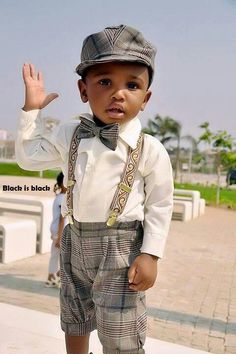 This is so cute it could almost convince me that having a little one is a good idea.  Baby fashion. Heeeeeey...what's up dude?  Somebody sign this dapper lad.