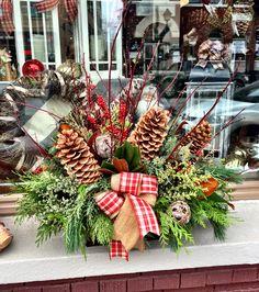 Beautiful seasonal arrangement.  By Caruso & Company