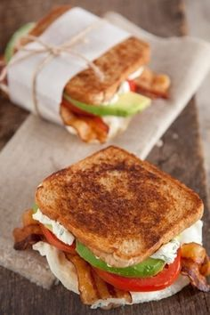 Fried Egg, Avocado, Bacon, Cream Cheese, Green Onion, Tomato Sandwich.